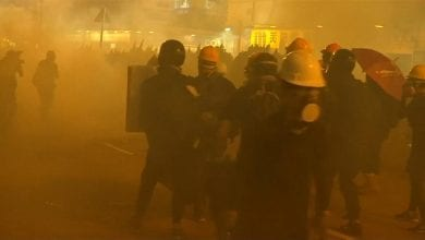 Photo of Police fire tear gas during anti-government protests in Hong Kong