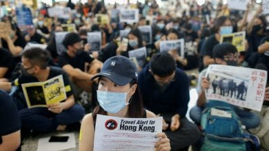 Photo of 'Dear travellers': Hong Kong protesters appeal to visitors at airport sit-in