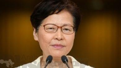 Photo of Hong Kong leader denies Beijing won't let her resign