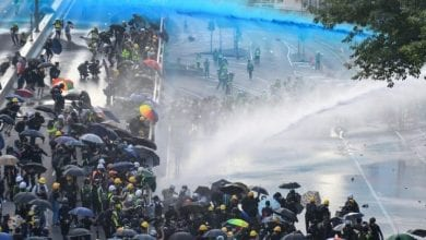 Photo of Hong Kong protesters hurl petrol bombs at government buildings in latest wave of unrest