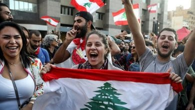 Photo of Lebanese protesters celebrate Hariri resignation, but want more