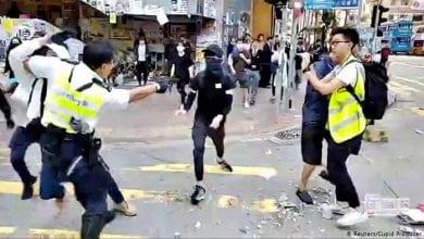 Photo of Hong Kong police shoot man during morning protests