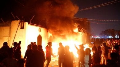 Photo of Protesters burn down Iranian consulate in southern Iraq