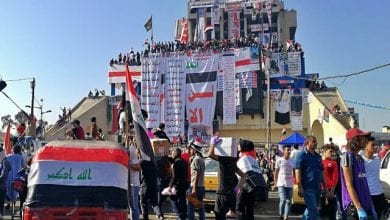 Photo of Iraqis defy crackdown to hold biggest protests yet
