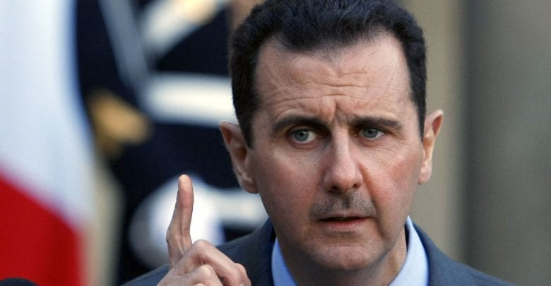 "Photo of Syria's al-Assad The battle to liberate Aleppo and Idlib and all of Syrian soil,"" Assad said"
