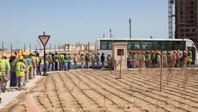 Photo of Qatar takes 'legal action' against companies after unpaid salaries trigger rare protest