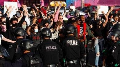 Photo de Manifestations et caméras documentant la violence policière