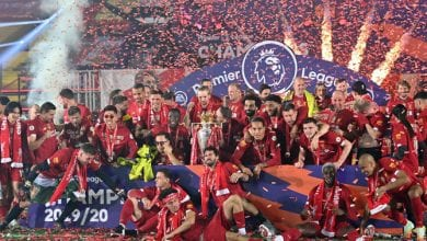 Photo of Liverpool players receive Premier League trophy on Kop